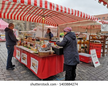 Nuremberg, Germany: March 2, 2019 The Nuremberg Bratwurst shop at the old town market square. Original Nurnberger with 3 pieces of sausage must be taste.