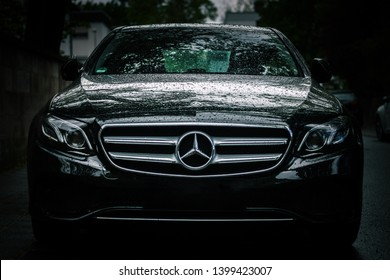 Nuremberg, Germany - May 13, 2019: Front view of luxury mercedes E class, toned down moody after rain dark feeling