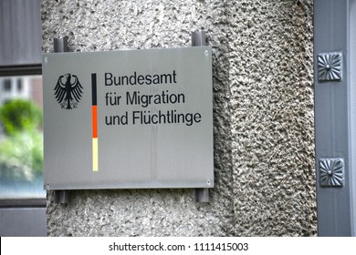 Nuremberg / Germany - May 20, 2018: Sign at the entrance of The Federal Office for Migration and Refugees in Nuremberg, The BAMF is the central migation authority in Germany