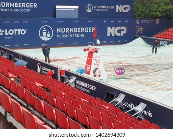 Nuremberg, Germany - May 20, 2019: Centre court at the Euro 250.000 WTA Versicherungscup Tournament covered during a rain interval
