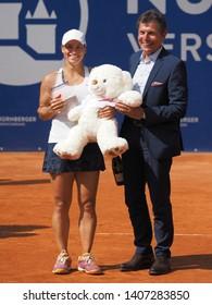 Nuremberg, Germany - May 25, 2019: Kazach tennis player Yulia Putintseva receiving the winner trophy at the Euro 250.000 WTA Versicherungscup