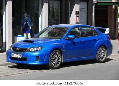 NUREMBERG, GERMANY - MAY 6, 2018: Blue Subaru Impreza WRX STI sports sedan car parked in Germany. There were 45.8 million cars registered in Germany (as of 2017).