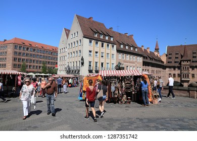 NUREMBERG, GERMANY - MAY 7, 2018: People visit Museumsbrucke (Museum Bridge) in Nuremberg, Germany. Nuremberg is located in Middle Franconia. 511,628 people live here.