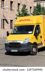 NUREMBERG, GERMANY - MAY 7, 2018: DHL courier delivery van in Germany. DHL is part of German national mail service - Deutsche Post.