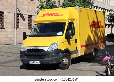 NUREMBERG, GERMANY - MAY 7, 2018: DHL package delivery van in Germany. DHL is part of German national mail service - Deutsche Post.