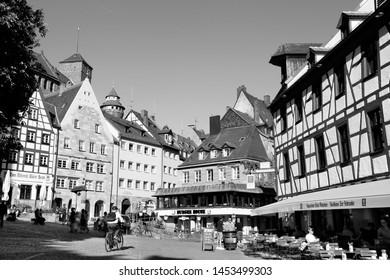 NUREMBERG, GERMANY - MAY 7, 2018: People visit the Old Town in Nuremberg, Germany. Nuremberg is located in Middle Franconia. 511,628 people live here.