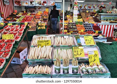 NUREMBERG, GERMANY - MAY 8, 2018: Asparagus at local vegetable market in Nuremberg, Germany. Nuremberg is located in Middle Franconia. 511,628 people live here.