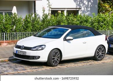 Nuremberg, Germany - September 19, 2019: White convertible car Volkswagen Golf in the city street.