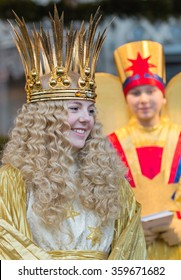 NUREMBERG, GERMANY-DECEMBER 2, 2015: Barbara Otto as an angel,  know as Christkind visits with the angel assistant the Main Market in Nuremberg during Christmas Market, known as Christkindlesmarkt