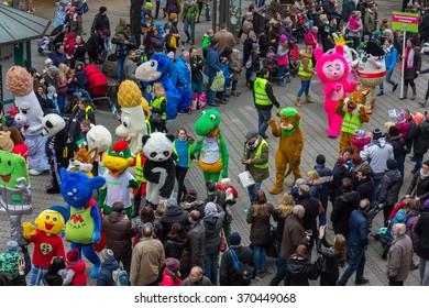 NUREMBERG, GERMANY-JANUARY 30, 2016: Toon Walk- mascots parade- during  International Toy Fair (Nuremberg Messe). Colorful, film, comics, cartoon characters walk through the downtown Nuremberg.