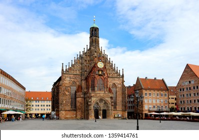 Nuremberg square in Bavarian Germany with the European old-world charm and gothic medieval church as its centerpiece.