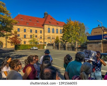 Nuremberg/Germany - October 12, 2018: Palace of Justice - Nuremberg Trials site. Tourists listening to a guide about the courthouse in Nuremberg, where the trials took place.
