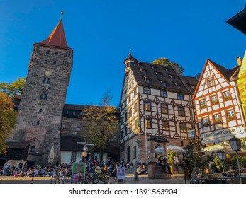 Nuremberg/Germany - October 12, 2018: Tourists and people from Nuremberg taking some minutes to relax in the city center.