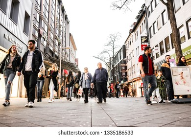 Nurmberg, GERMANY - February 27, 2019: Old woman and man walking on shopping street