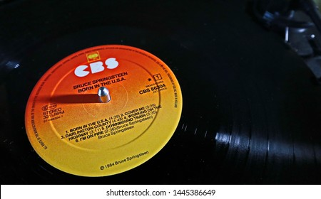 Nurmijarvi, Finland -07-08-2019: Bruce Springsteen vinyl record Born in the U.S.A. on a turntable record player, selective focus