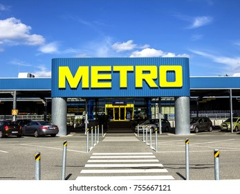Nurnberg, Germany - July 29, 2017: Metro logo, facade of a supermarket. Metro cash and carry is a leading international player in self service wholesale trade