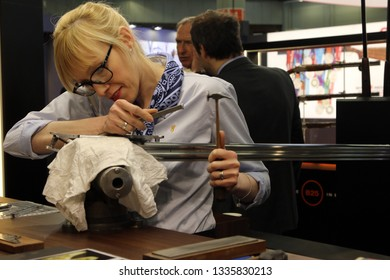 NURNBERG, GERMANY - MARCH 8: Browning representative shows hand engraving process on a gun barrel at IWA 2019 & Outdoor Classics exhibition