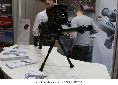 NURNBERG, GERMANY - MARCH 8: Fortuna General LRF night vision scope installed on a rifle on display at IWA 2019 & Outdoor Classics exhibition