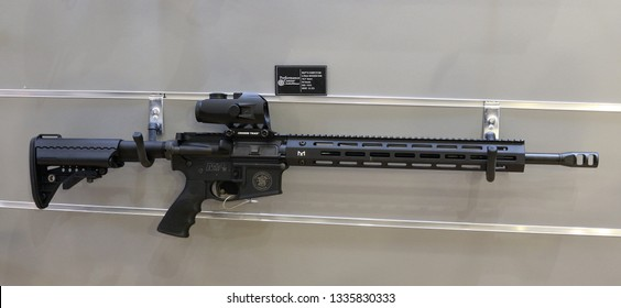 NURNBERG, GERMANY - MARCH 8: Smith & Wesson M&P 15 Competition AR 15 rifle with Crimsion Trace scope on display at IWA 2019 & Outdoor Classics exhibition