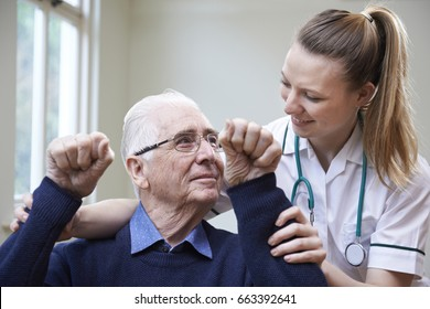 Nurse Assessing Stroke Victim By Raising Arms