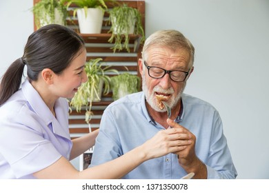 Nurse assist senior man having breakfast together