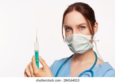 Nurse in blue dress with Op stethoscope and syringe as Cut .