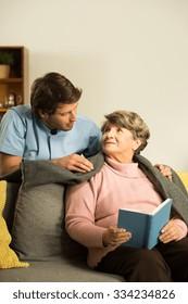 Nurse caring about senior patient in nursing home