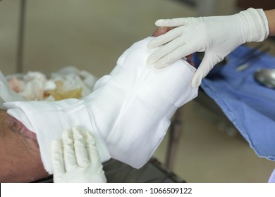 Nurse change the dressing of wound at emergency room