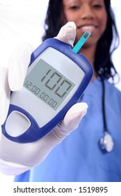 Nurse checking diabetic's blood sugar