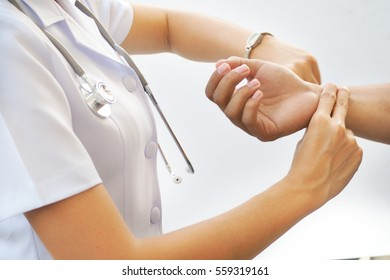 nurse is checking patience's pulse, medical checking on white back ground. Asian nurse.