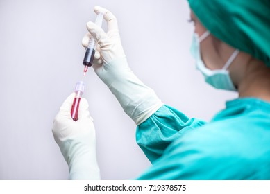 Nurse collecting a blood from syringe