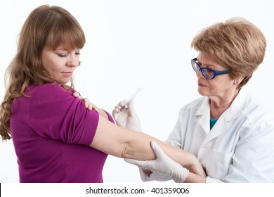Nurse do an inoculation the young woman, white background