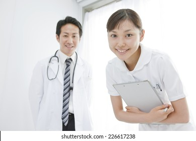 Nurse and doctor questioning patients