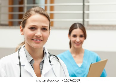 Nurse and a doctor standing in a hospital reception