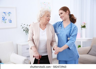 Nurse and elderly women in light room