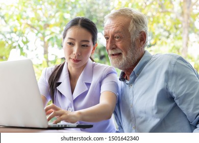 Nurse help senior retirement man working with laptop in the garden at home and feeling happy