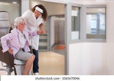 Nurse helping disabled lady in getting up
