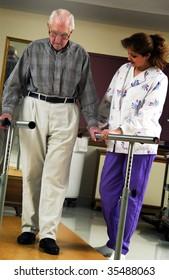 nurse helping senior man with physical rehabilitation