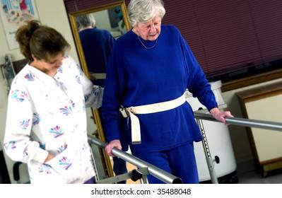 nurse helping senior woman with physical rehabilitation