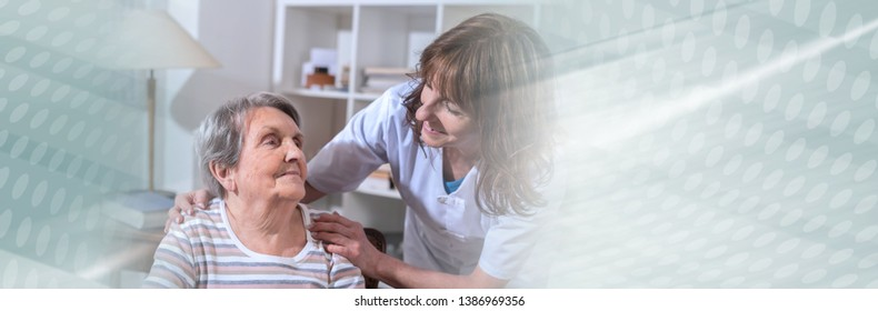 Nurse with her hands on the shoulder of a senior woman. panoramic banner