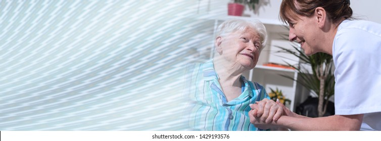 Nurse holding the hand of an old woman. panoramic banner