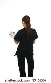 A nurse holding her chart making rounds