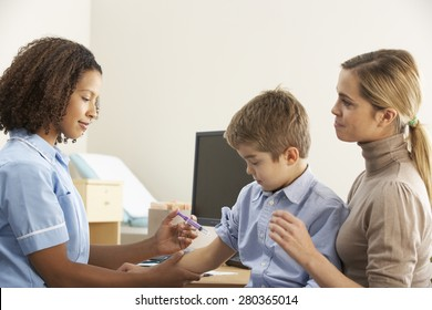 Nurse injecting child with mother