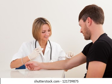 Nurse making injection to patient in clinic