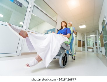 Nurse moves mobile medical chair with patient at hospital. Medical equipment. Concept