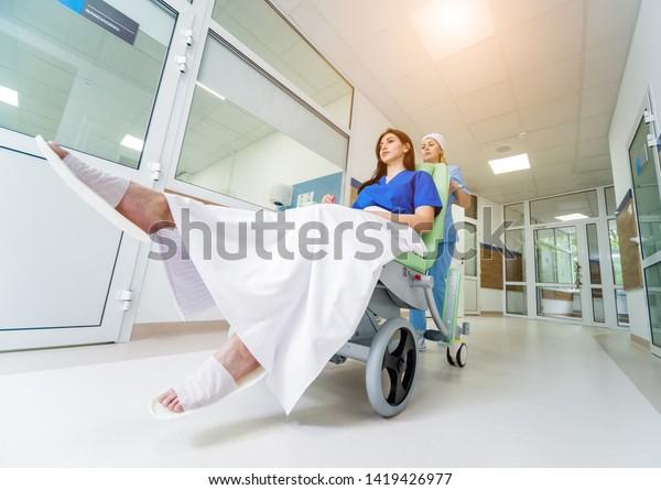 Nurse Moves Mobile Medical Chair Patient Stock Photo (Edit