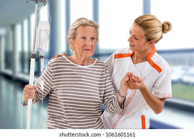 Nurse next to a patient in hospital ward
