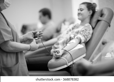 Nurse receiving blood donation in hospital