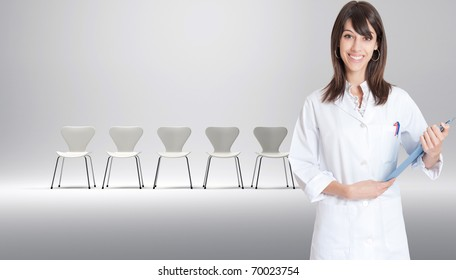 Nurse with a row of white chairs at the background