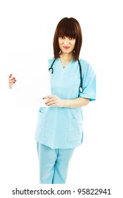 Nurse showing medical sign billboard standing. Young smiling woman nurse or doctor showing empty blank sign board with copy space. Isolated on white background.